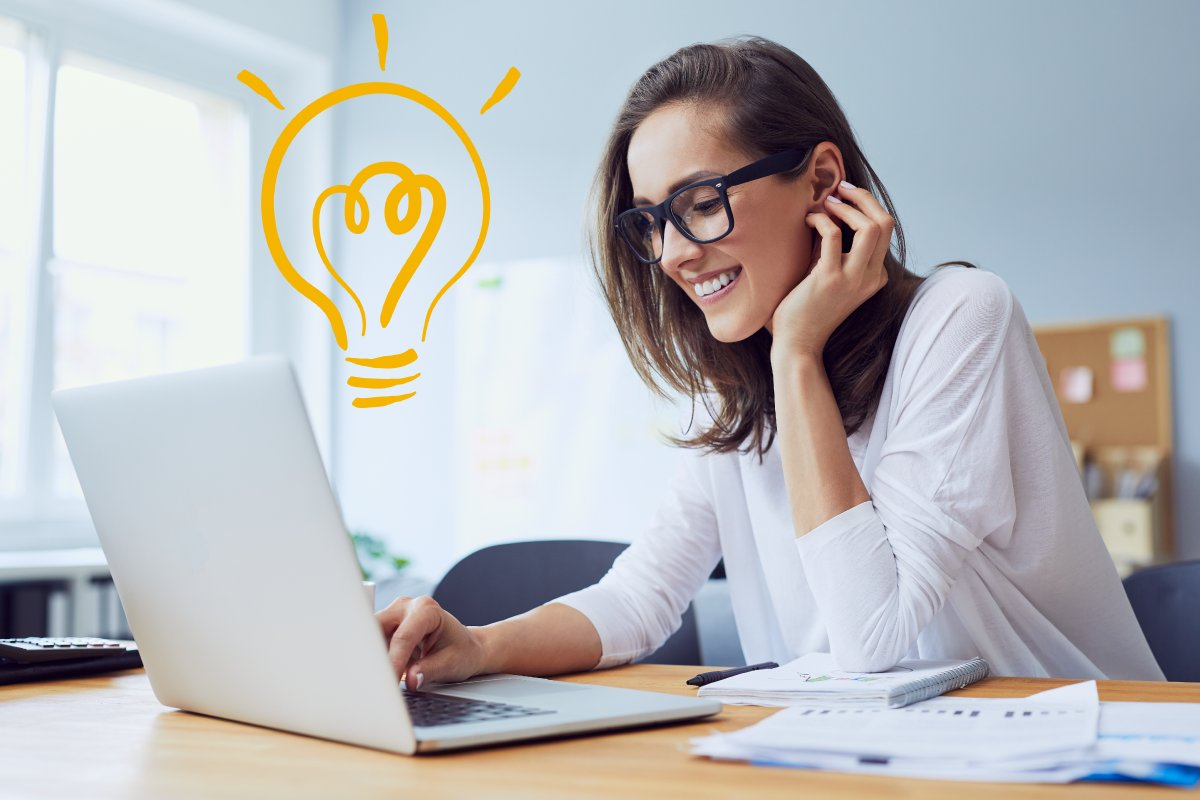 Woman at laptop connected to Taskalfa